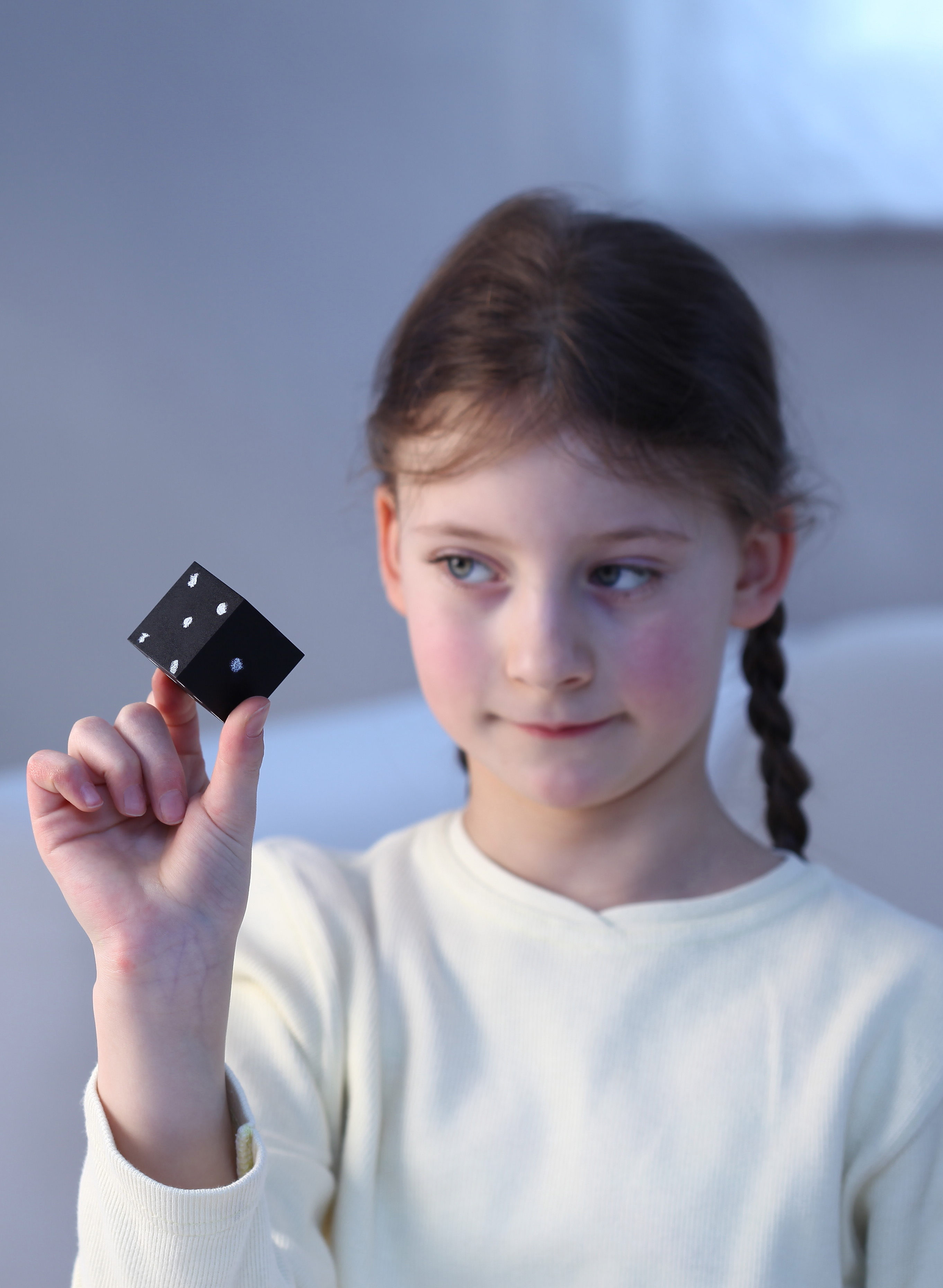 Child with a black cube from Colorem by Naef Spiele Switzerland